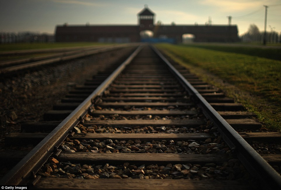 More than 1.1million people were killed at infamous Nazi death camp Auschwitz before liberation by the Red Army in 1945, pictured is the Death Gate at Auschwitz II Birkenau